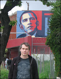 Artist Shepard Fairey in front his poster that spawned millions of copies