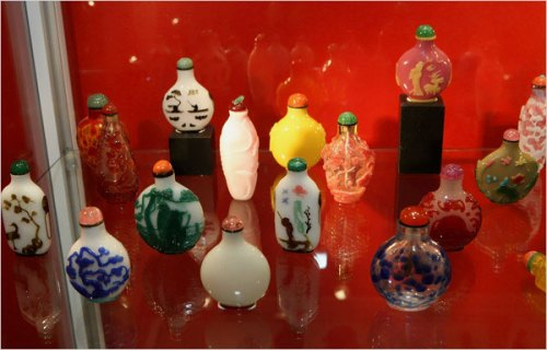 Brightly colored glass snuff bottles at the Asian Art Studio Booth of the New York Arts of Pacific Asia Show