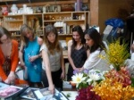 Reviewing images of past floral installations at Holly Flora Studio
