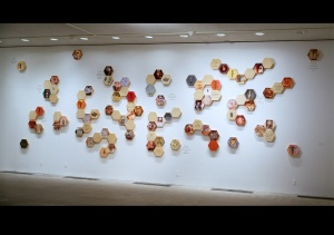 "Nancy Macko, The Honeycomb Wall, 1993-94, mixed media, 9 X 20' X 2"", each panel 11.5 inches in diameter Installed at The Center for the Arts, Jackson Hole, WY, 2009"
